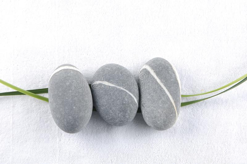 Stones and bamboo-leave royalty free stock photo