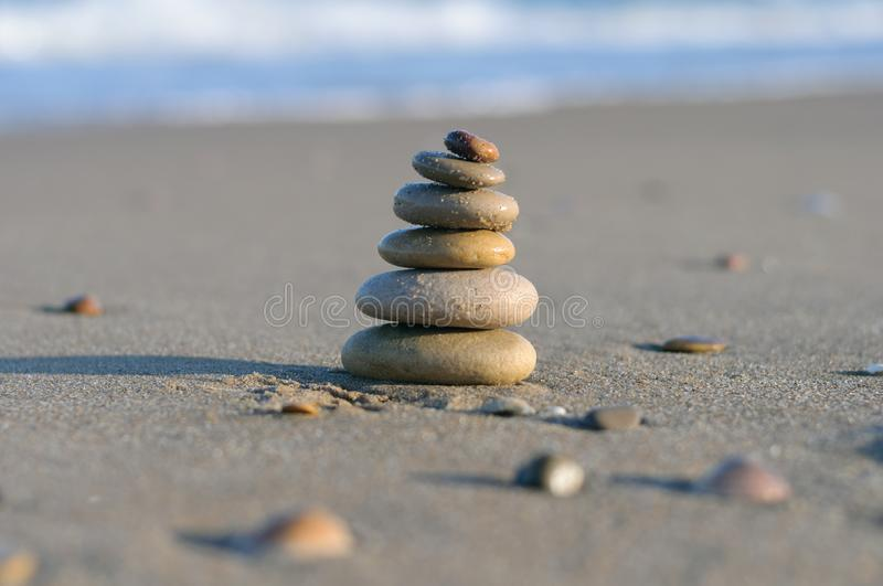 Stones on the beach in the form of a pyramid royalty free stock photo