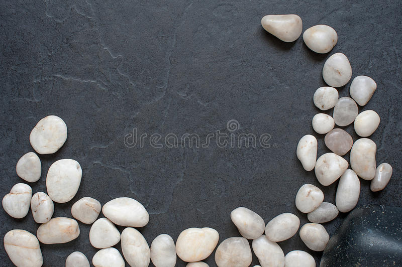 Stones on a black background. Light various stones on a black background royalty free stock image