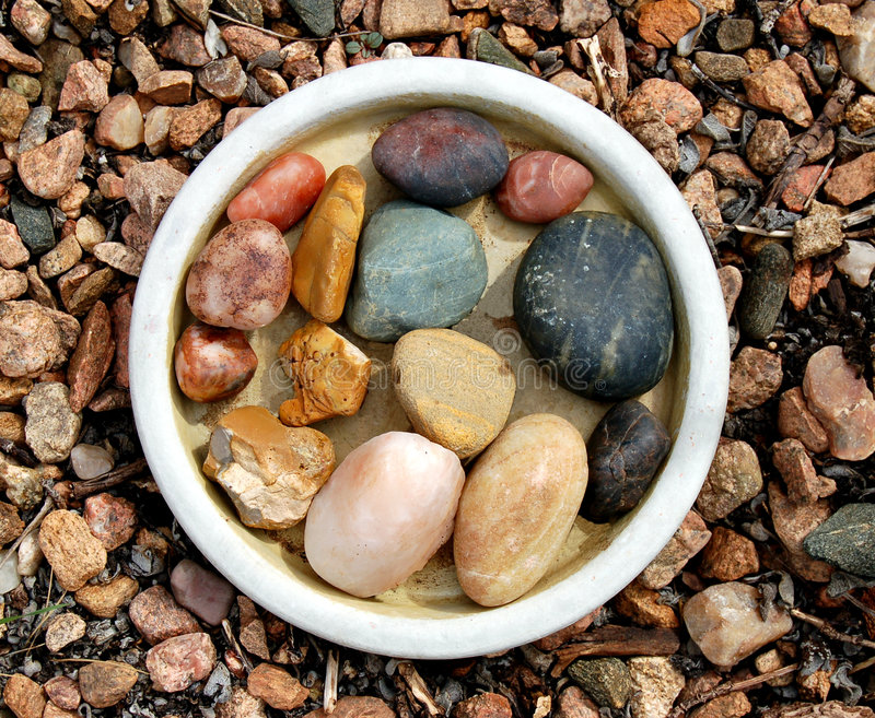 Stones in a Bowl. Collection of stones in a round bowl stock image