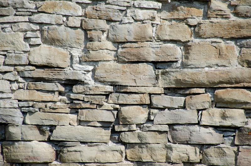 Stones and bricks of old medieval castle. Texture of wall royalty free stock photo