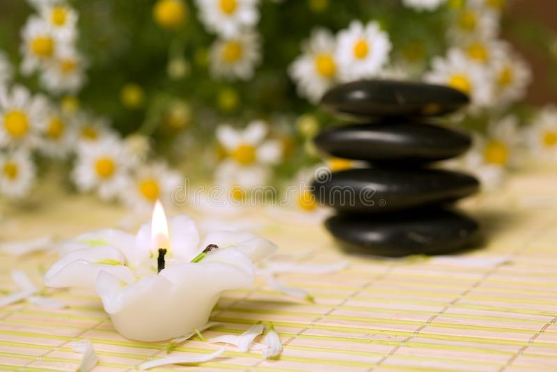 Stones and candle. An image of stones for spa massage and candle royalty free stock photography