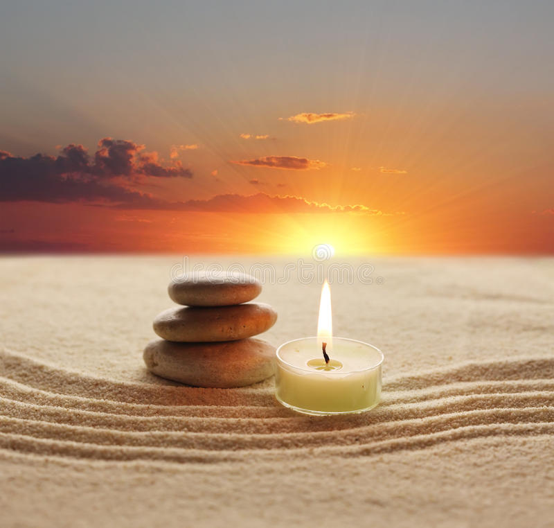 Stones and candle light stock images