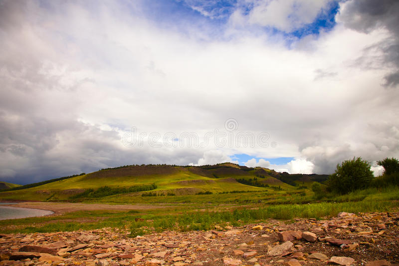 Stones And Green Hills Royalty Free Stock Images