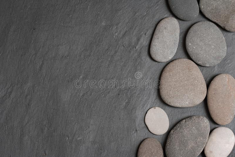 Stones on the grey background stock photography