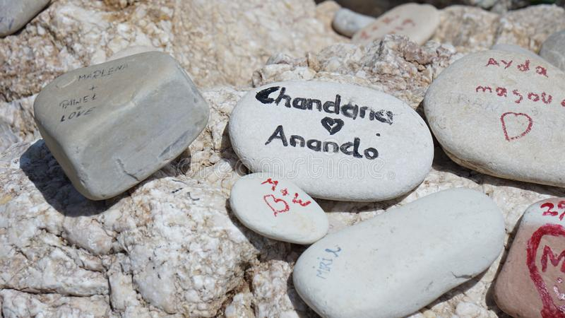 Stones with inscriptions on the beach of Cyprus in the summer stock images