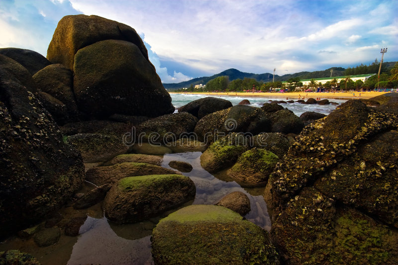 On stones of Karon. Photografed on Karon beach, Phuket Island, Thailand stock photography