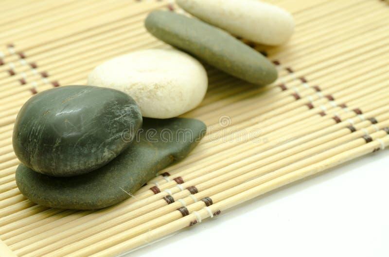 Stones on mat