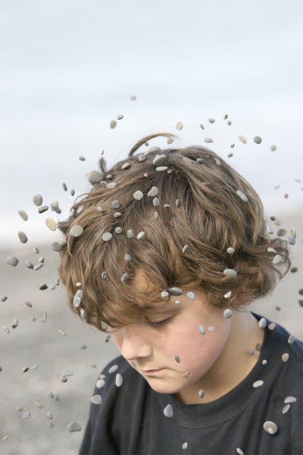 Download Stones In Midair Around Boy Stock Image - Image: 1263231