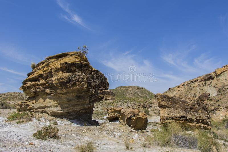 Stones and mountains in the desert. Rocks in the desert of almeria, region of andalucia, spain royalty free stock images