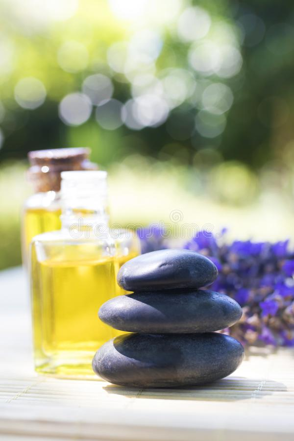 Stones and natural massage oils royalty free stock photos