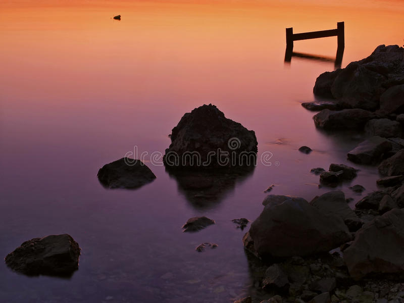 Stones at orange sea royalty free stock photos