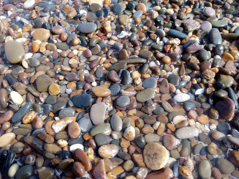 Stones pattern. Different colors and fomes stones lying on the ground, creating a beautiful pattern royalty free stock photography