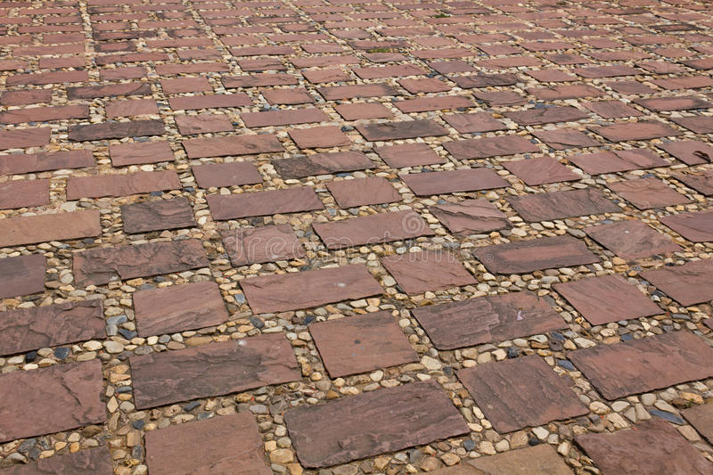 Stones of the pavement. Pattern of brick background royalty free stock photos