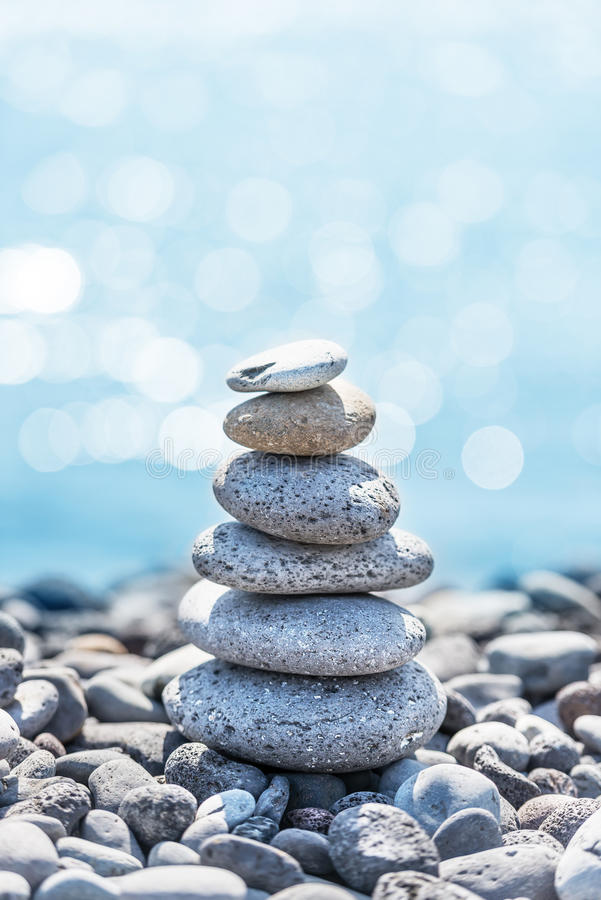 Stones pyramid with ocean on background royalty free stock image