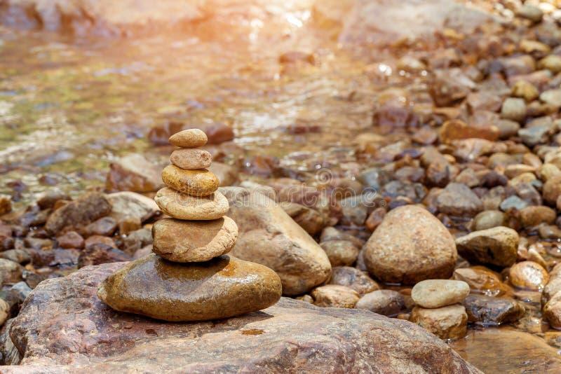 Stones pyramid at waterfall royalty free stock photo