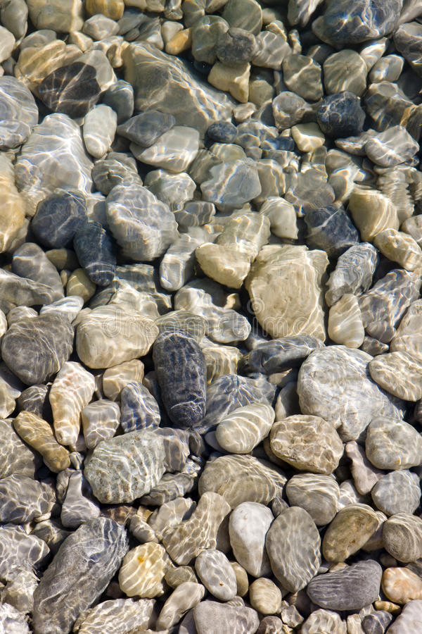 Stones in river. Background made of stones in river stock image