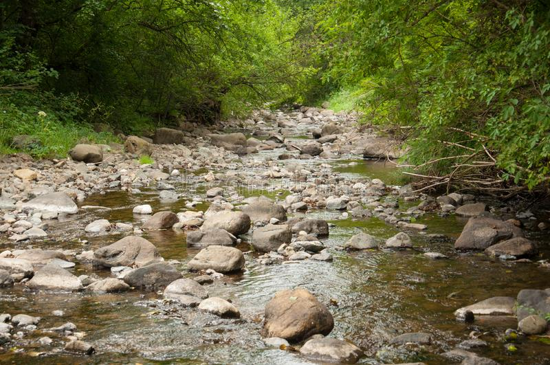 Stones in river.Stone and water royalty free stock photos