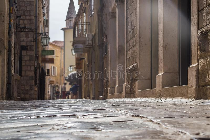 Stones rubbed to the shine of the old city in perspective. Budva. Montenegro.  royalty free stock images