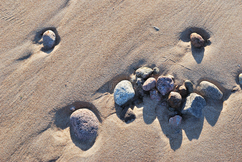 Download Stones on  the sand stock photo. Image of sand, shadows - 26877340