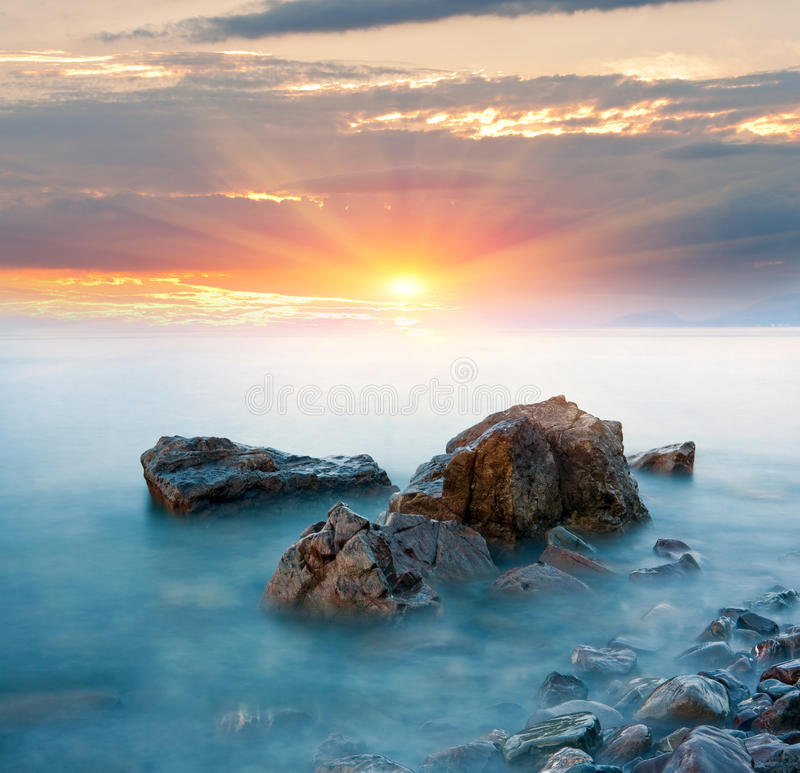 Stones in sea water stock images
