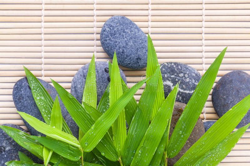 The Stones spa treatment scene on bamboo background . royalty free stock photography