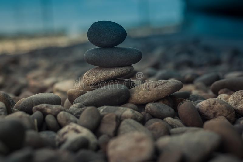 Stones stacked - esoteric symbol of balance and equilibrium royalty free stock images