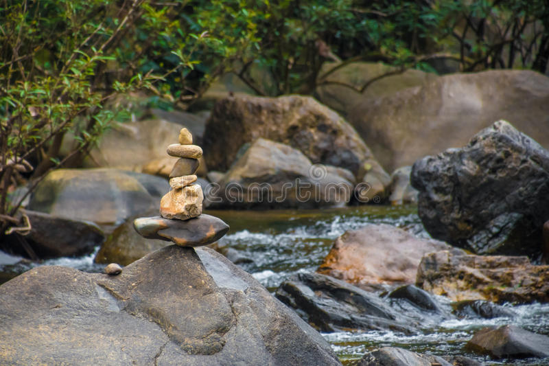 Stones stacked on top of each other at river in Thailand stock photo