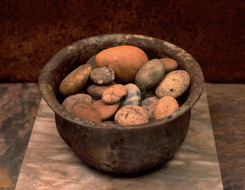 Zen Stones In a Bowl On Stone  stock photos