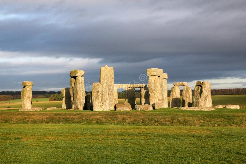 The stones of Stonehenge, a prehistoric monument in Wiltshire, England. UNESCO World Heritage. Ancient uk salisbury bc site old landscape grass tourism circle stock photo
