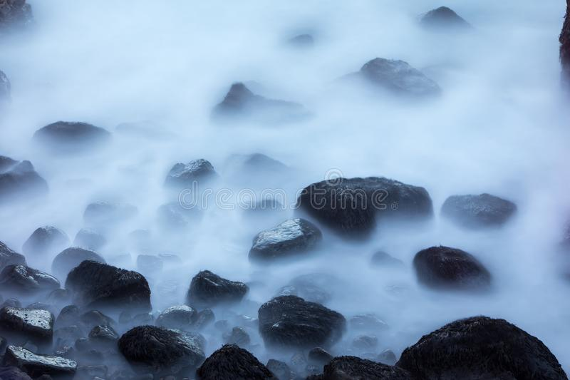 Stones in a stream with water blurred by long exposure using ND. Filter (Soft Focus), Iceland stock images