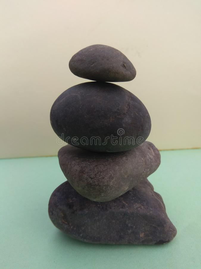 Stones supporting each other stock photo