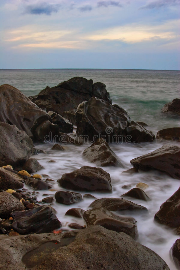 Stones in tide royalty free stock photo