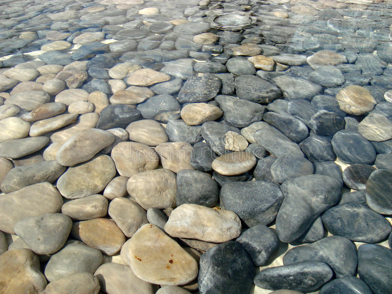 Stones under the water stock photo