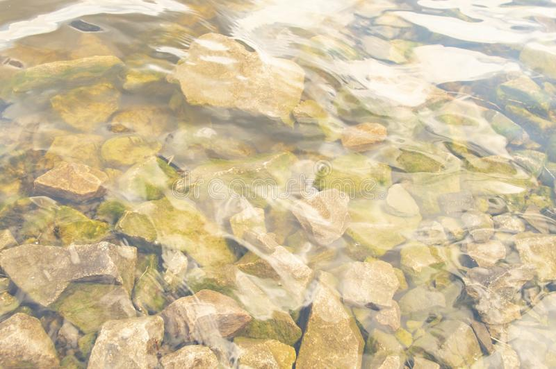 Stones under water at the bottom of the river royalty free stock photo