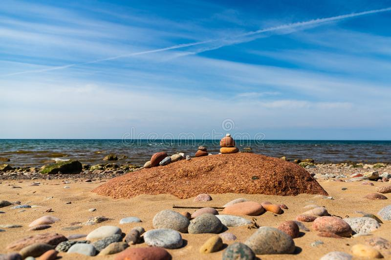 Stones of varying size on the seashore. Stones of varying size are on the seashore stock photography