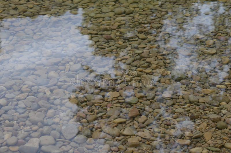 Stones in the water pattern. Stones in the river water pattern stock photos