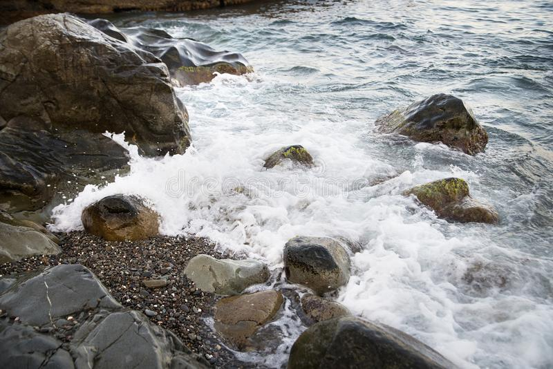 Stones with water and spray, splash. Sea coast. Stones with water and spray, splash stock photography