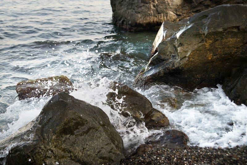 Stones with water and spray, splash. Sea coast. Stones with water and spray, splash royalty free stock photography