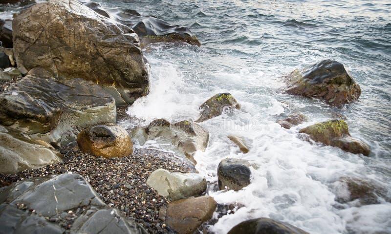 Stones with water and spray, splash. Sea coast. Stones with water and spray, splash royalty free stock photo
