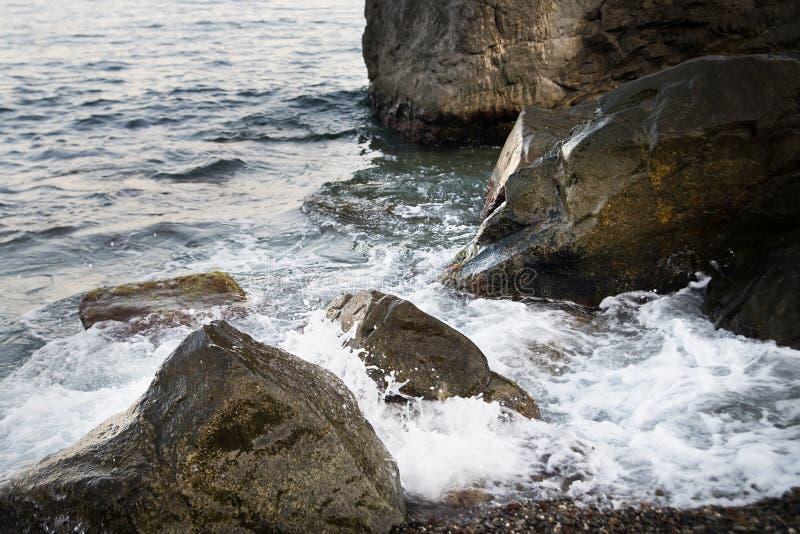 Stones with water and spray, splash. Sea coast. Stones with water and spray, splash stock image