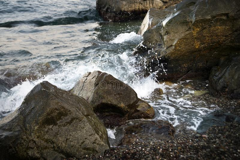 Stones with water and spray, splash. Sea coast. Stones with water and spray, splash royalty free stock images