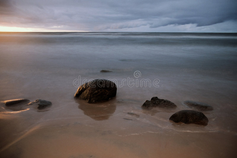 Stones at waterfront - some gr royalty free stock photography