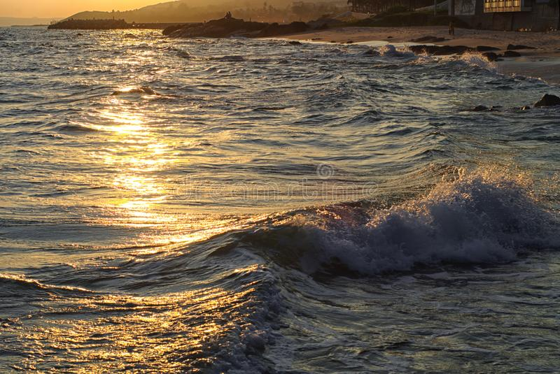 Stones among the waves on the Mui Ne beach royalty free stock image