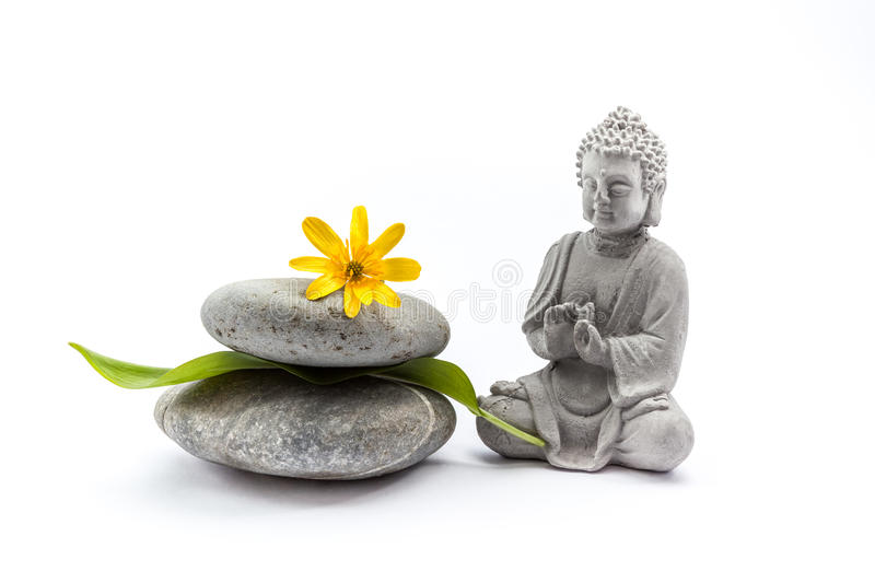 Stones whit flower and Buddha stock photography