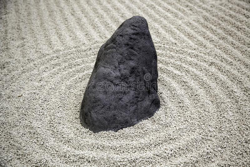 Stones in a Zen garden. Detail of Japanese meditation, tranquility, health, mini, traditional, spiritual, asian, background, rock, horizontal, spa, stack royalty free stock images
