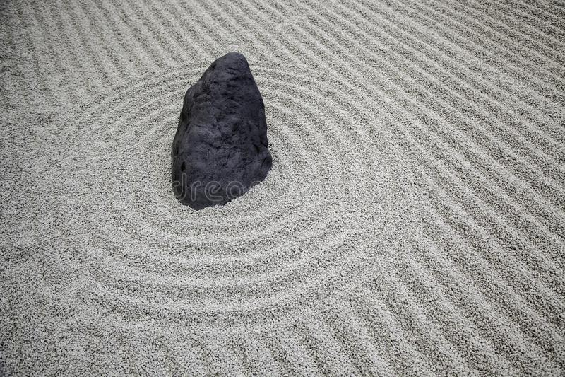 Stones in a Zen garden. Detail of Japanese meditation, tranquility, health, mini, traditional, spiritual, asian, background, rock, horizontal, spa, stack stock photos