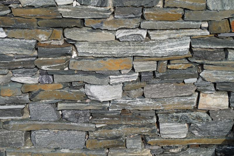 Stonewall and bricks. Wall of bricks or Stones and fugues royalty free stock photos