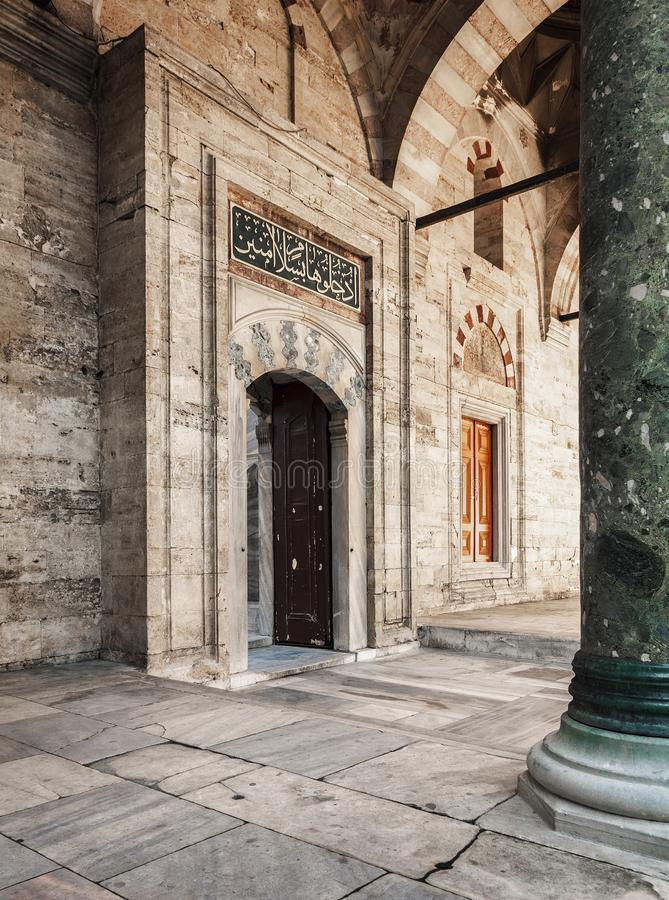 Istanbul mosque courtyard. Stonework and doors in the courtyard of Beyazit mosque. Istanbul, Turkey royalty free stock photography