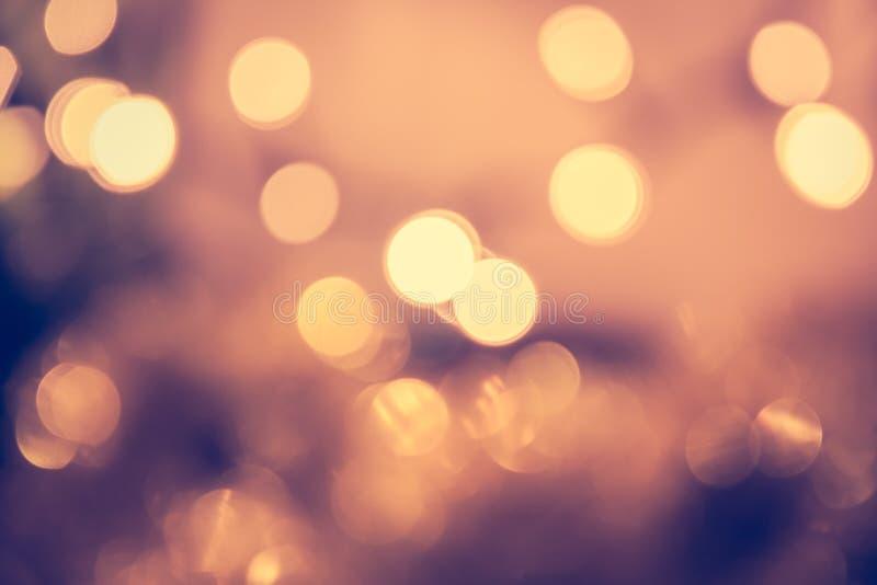 Stonowany bokeh z mruganie bożonarodzeniowe światła w rocznika stylu obrazy royalty free
